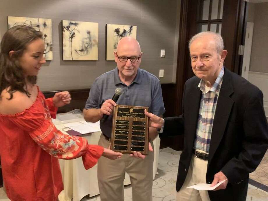 EMT Caroline Hess and WVAC President, John Miscioscia, center, present Ron Hitter with the Fairchild Award on June 20 in Wilton, Conn. His name has been added to the plaque that is hung at headquarters as the third recipient of this annual award. — Contributed photo / Wilton Bulletin Contributed