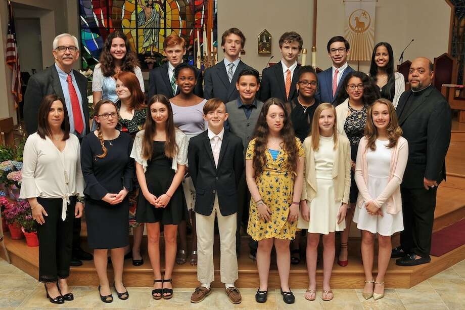 With Our Lady of Fatima graduates are, at left, in front, ELA Middle School Teacher, Danielle Mancuso; at right, middle row, the Rev. Reginald Norman, Our Lady of Fatima Church pastor, and at left, back row, Principal Stanley Steele. — Lifetouch photo