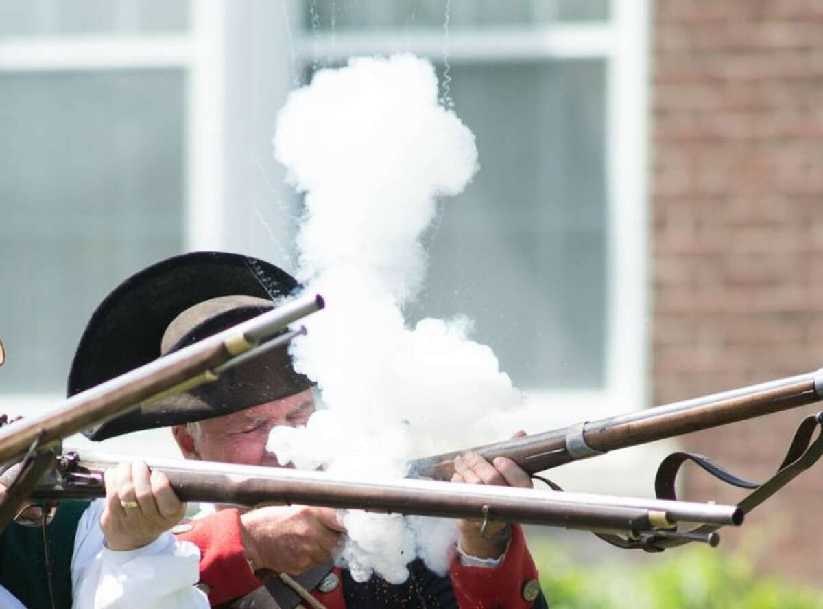 Ready, aim, fire! Roger Smith shoots a musket causing noise and smoke at Living History Day in Bethel. - Bryan Haeffele/ Hearst Connecticut Media photo