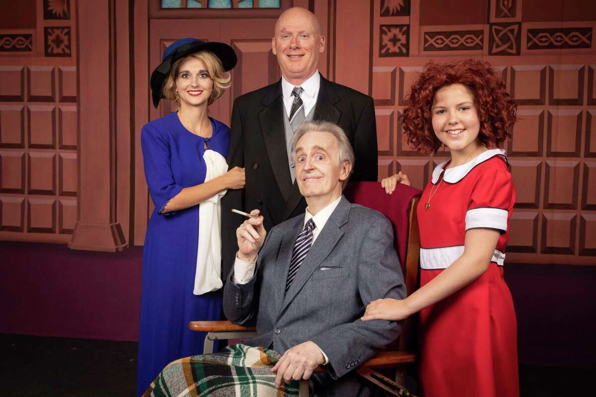 """Pictured from left are Kathleen Baker as Grace, Bob Turner as Warbucks, Emma Dantzler as Annie and in the wheelchair, John Kaiser as President Franklin Roosevelt in Stage Right's """"Annie"""" now on stage at the Crighton Theatre."""