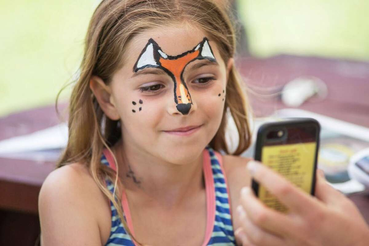 Allison Massaua, 8, of Wilton has her face painted as a fox at Wilton Day.