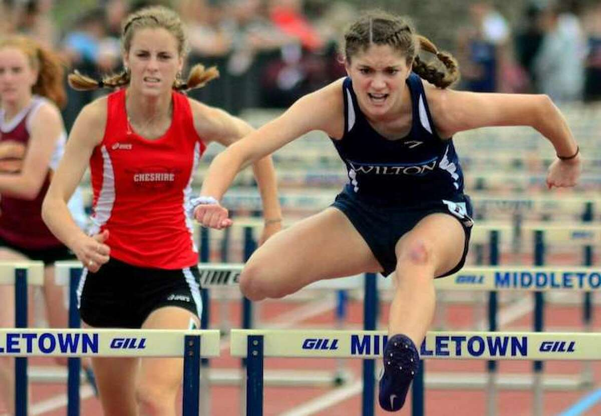 Shelby Dejana on her way to a first-place finish in the 110-meter hurdles at the Class L state championship meet. - Christian Abraham / Hearst Connecticut Media