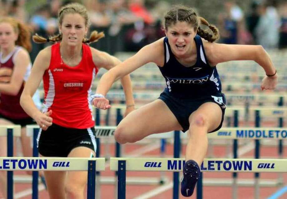 Shelby Dejana on her way to a first-place finish in the 110-meter hurdles at the Class L state championship meet. — Christian Abraham / Hearst Connecticut Media