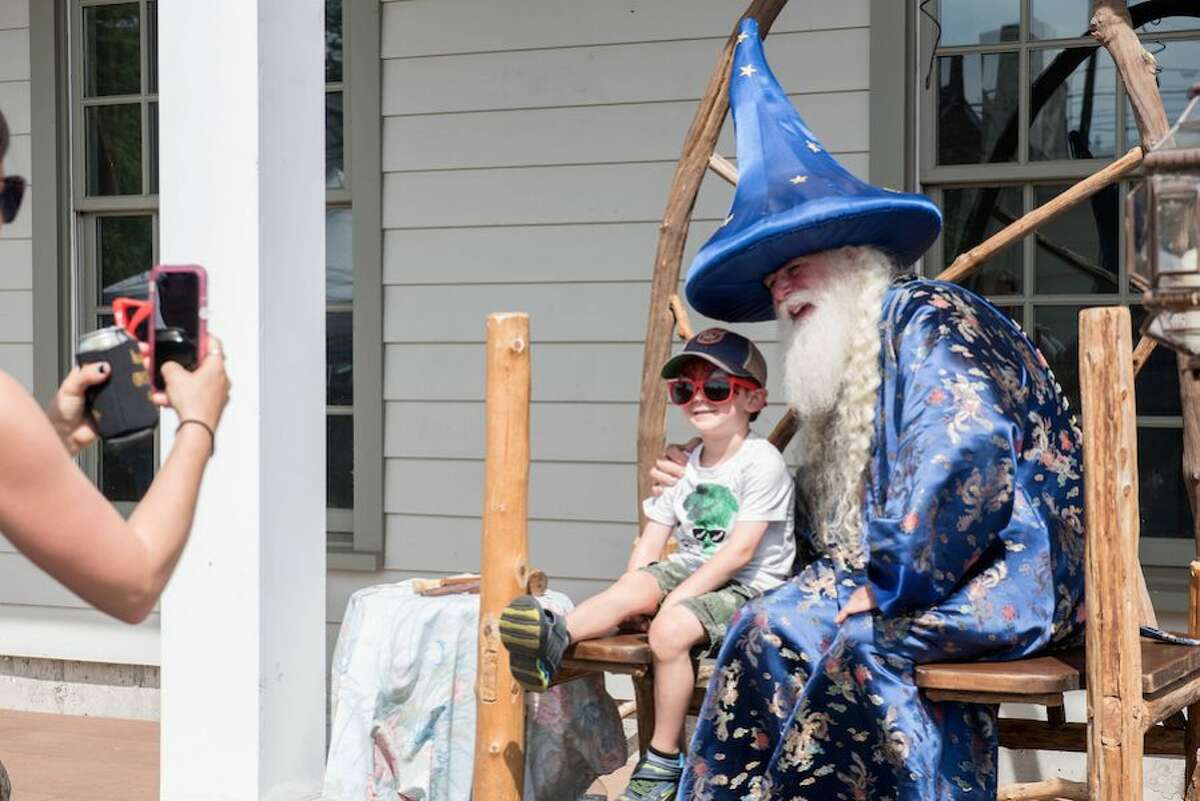 """Ziggy Sommer, 4, of Wilton has his picture taken with """"Waka the Wizard."""""""