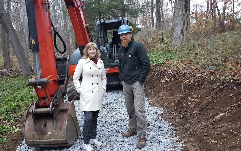 Pat Sesto, president of the Friends of the NRVT, joins trail builder Josh Ryan of Timber & Stone during construction of the Wilton Loop portion of the Norwalk River Valley Trail.