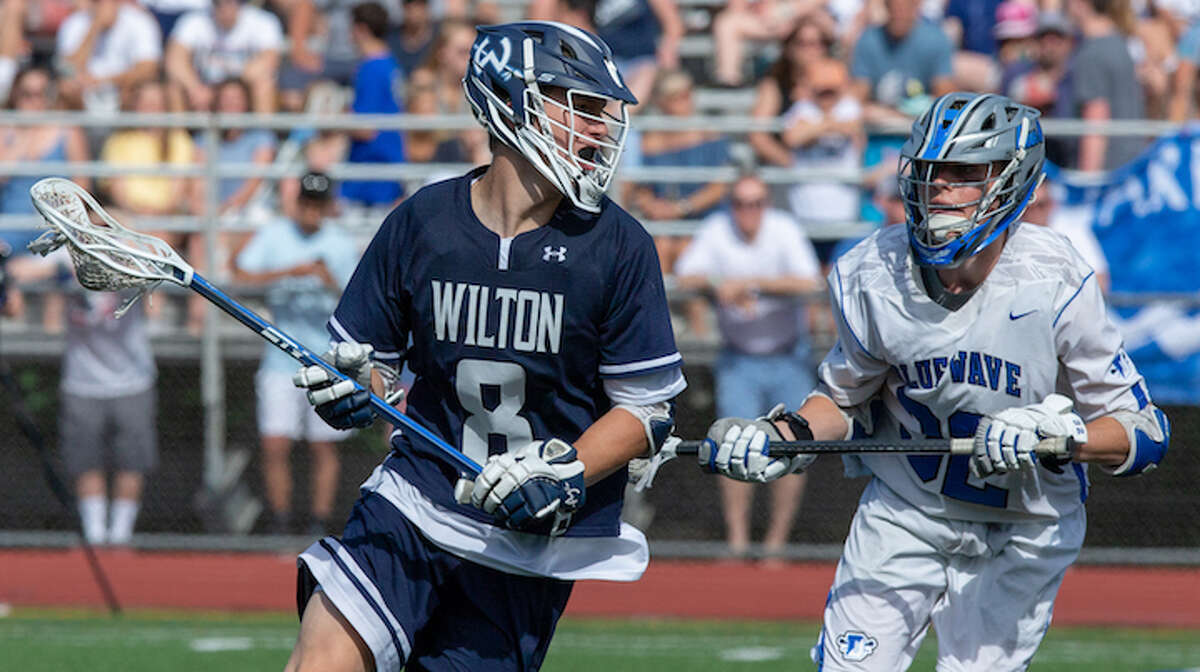 Andrew Luciano gets ready to score the first of his two goals in Wilton's 13-3 loss to Darien in the Class L state finals. - GretchenMcMahonPhotography.com
