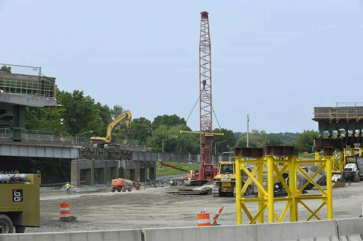 Work crews work to remove a dilapidated Route 1 bridge on June 1, 2019 that spans I-95 at exit 9 in Stamford, Conn., making way for new spans of prefabricated bridge. -Matthew Brown / Hearst Connecticut Media