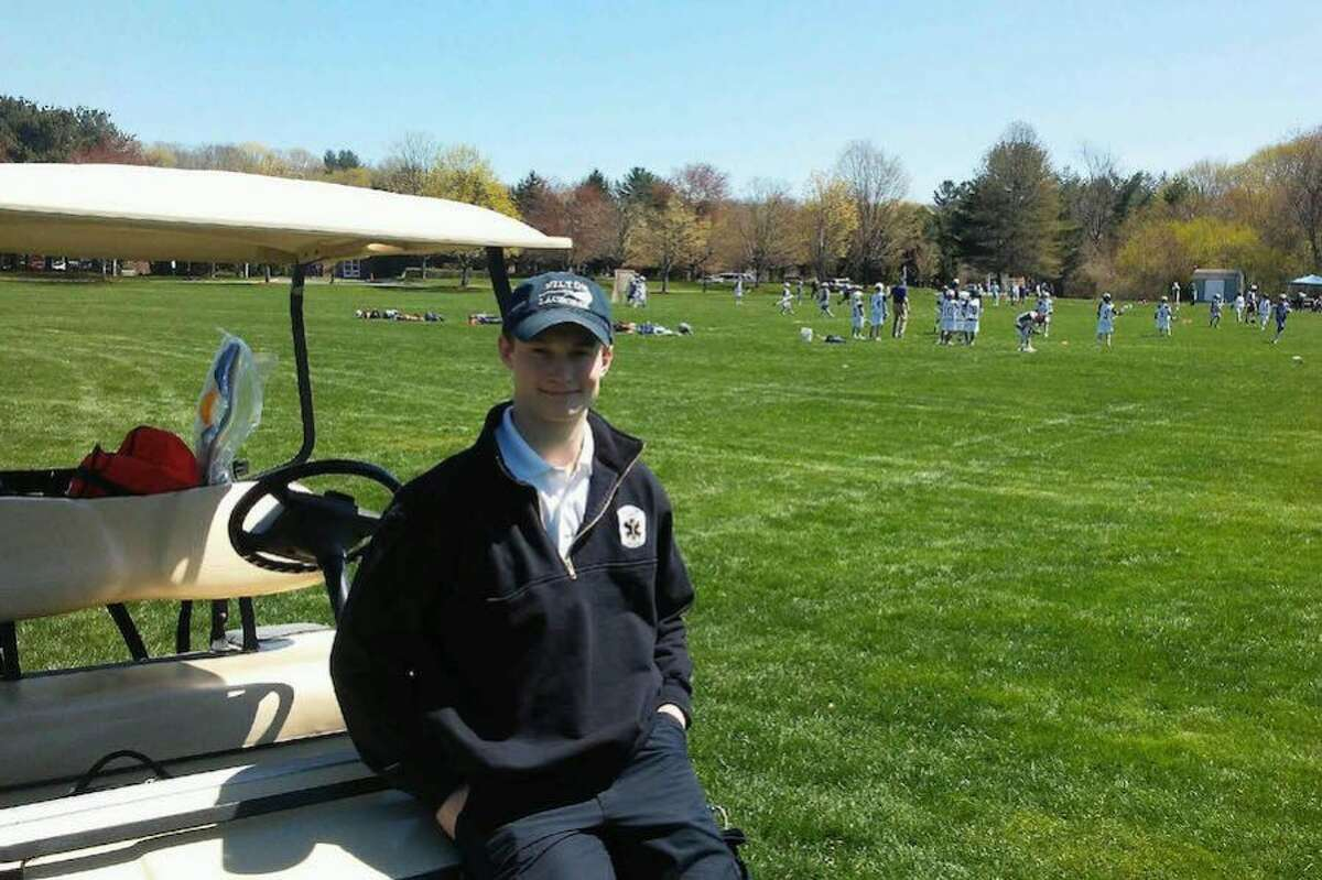 Wilton Volunteer Ambulance Corps EMT Chris Sweeney on call at an athletic event. Sweeney helped save the life of a man who was electrocuted. - Contributed photo