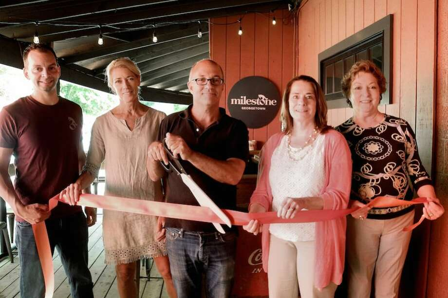 At the Milestone ribbon cutting on June 6 in Georgetown are, from left, bartender John Ross, marketing specialist Sheree Loud, owner Peter Fine, Wilton Chamber of Commerce President Susan Goldman, and Chamber Executive Director Debra Hanson. — Jeannette Ross/Hearst Connecticut Media