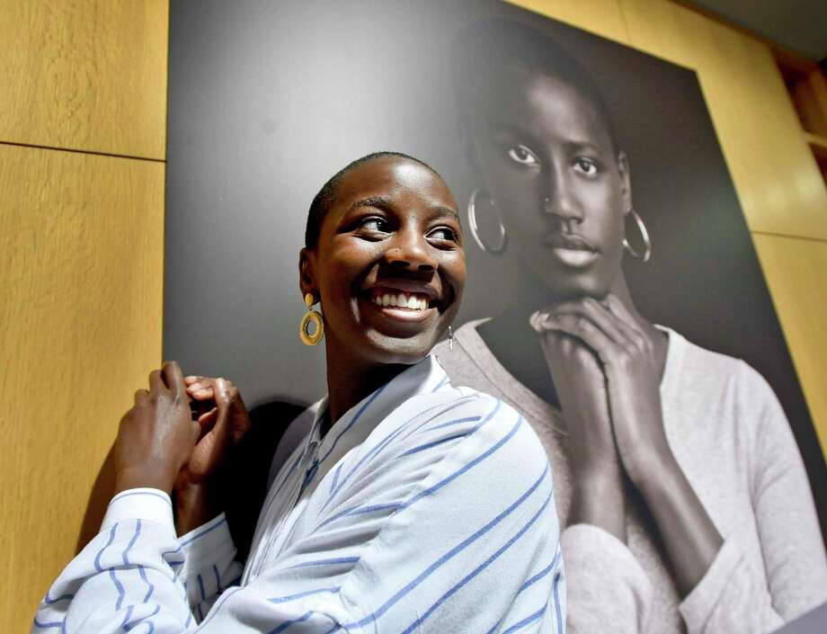 "New Haven, Connecticut - Monday, June 24, 2019: Nyla Conaway, 18, of New Haven, who posed for a photograph for the ""iMatter"" project, has her photograph made before the start of the City of New Haven Youth Services Department reception Tuesday afternoon at the City Hall Atrium unveiling ""iMatter"", a 10-photo ""i-Matter"" installation of New Haven youth by photographer Rob Goldman of Guilford. In partnership with the Livable City Initiative, three 9-foot high ""iMatter"" Towers of photos will be permanently installed in September on the traffic island at the intersection of Dixwell Avenue, Munson Street and Shelton Avenue in New Haven. Photo: Peter Hvizdak / Hearst Connecticut Media / New Haven Register"