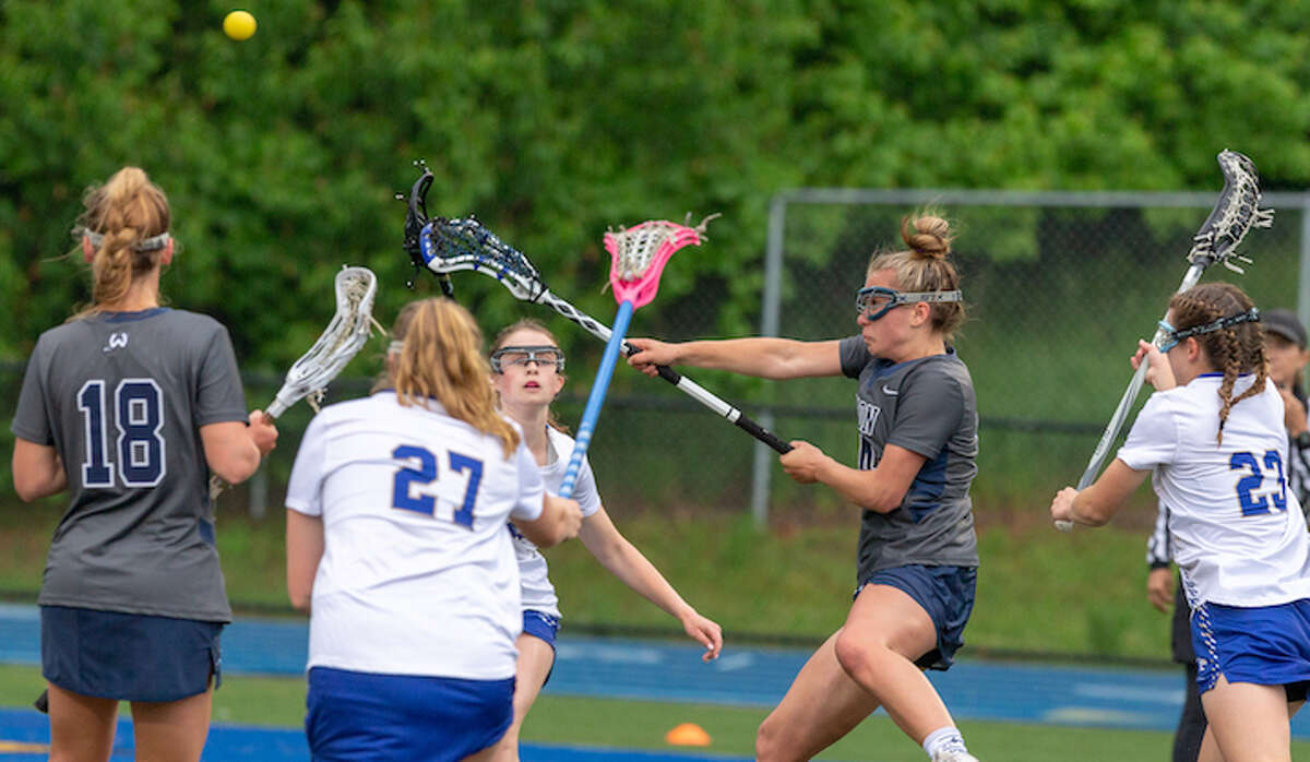 Carly Sullivan scores a goal for Wilton in Tuesday's state tournament win over Newtown. - GretchenMcMahonPhotography.com
