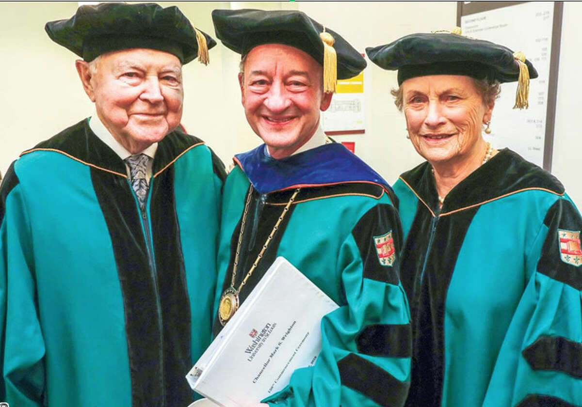 George, left, and Carol Bauer of Wilton, Conn., receive honorary degrees from Washington University in St. Louis. Joe Angeles/Washington University photo