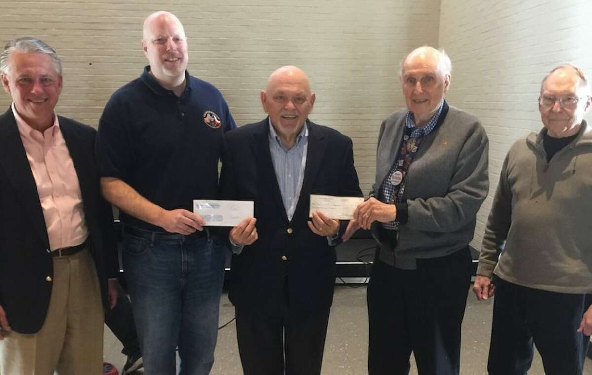 At the check presentation, from left, are Paul Michalski, president of New Canaan Society, supporter of the Bridgeport Rescue Mission; Ken Bopp, acting director of community development for Grace Community Church; Terry Wilcox,, executive director of the mission; Kiwanian Fred Sindel, liaison between the Kiwanis foundation and the mission; and Dave Hapke, chairman of the Kiwanis contributions committee.
