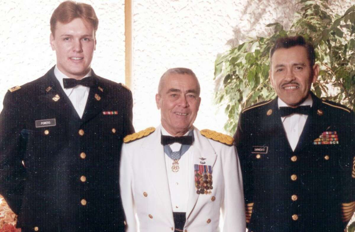"""John """"Sean"""" Powers, left, at his graduation from Army flight school. With him are Chief Warrant Officer 4 Mike Novosel, center, and First Sergeant Sarmiento."""