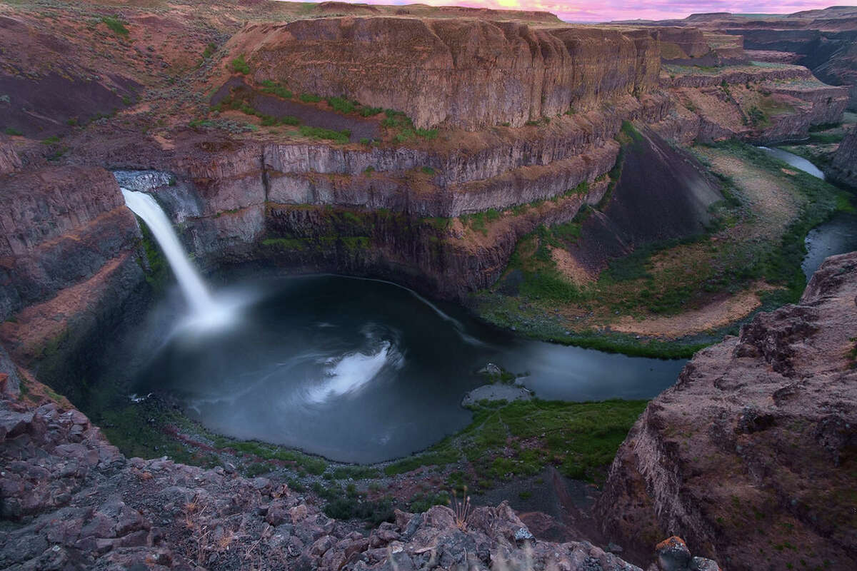 With the summer sun comes heated hiking, so cut yourself a break and cool off in some of these Washington waterfalls and swimming holes throughout the Evergreen State. Here, the 198-foot Palouse Falls cascades into the depths of eastern Washington. Keep clicking for seven of the state's top natural swim spots.