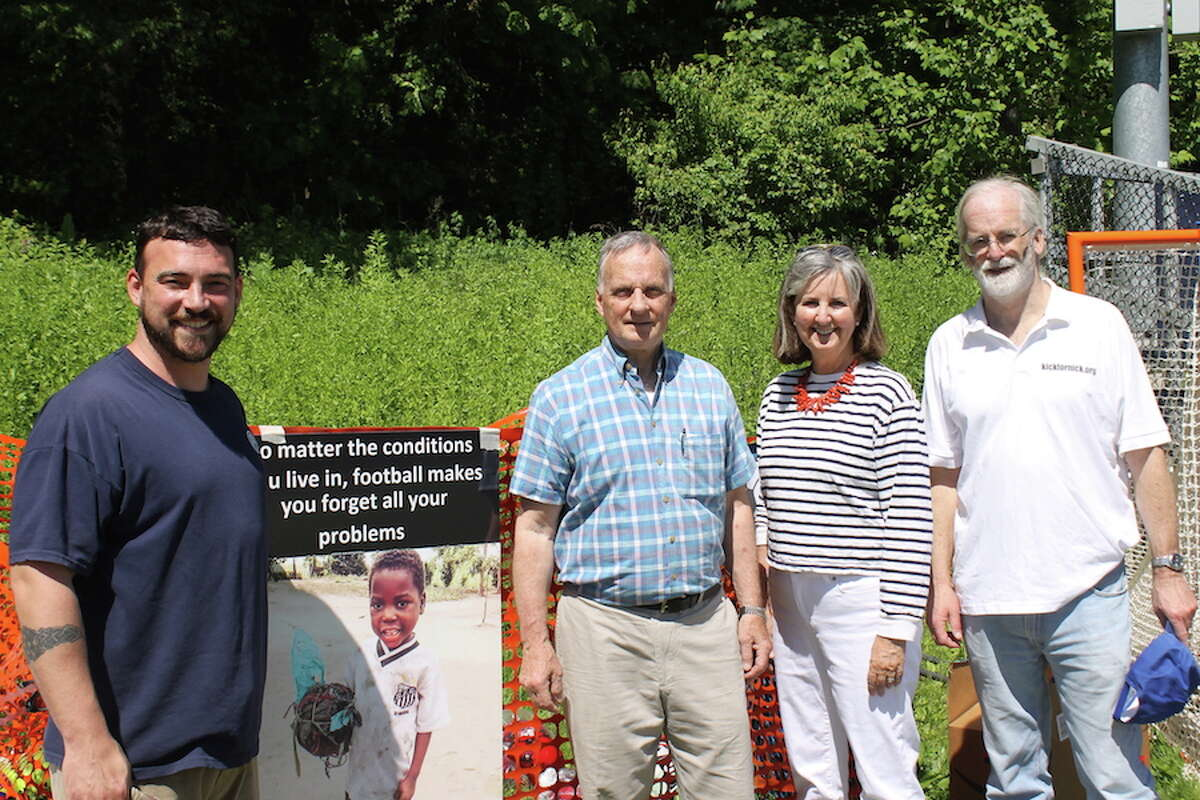 From left, Army veteran Sgt. Sean Curran, owner of Curran Volkswagen, Stratford, which donated $20,000 to the Kick for Nick Memorial Day Challenge; Bill Madaras, longtime supporter and volunteer Denise Walsh and Paul Burnham. - Shalini Madaras photo