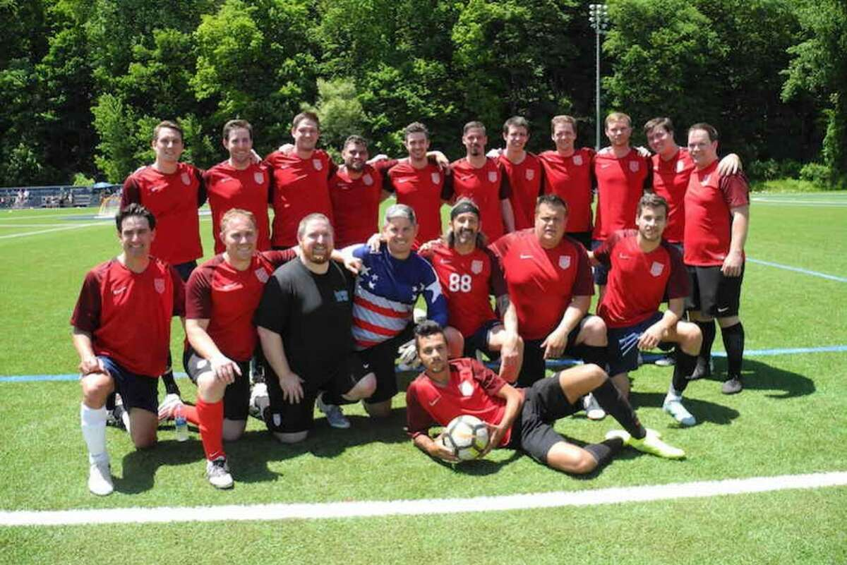 Nick Madaras' former teammates and friends made up the alums team. - Jeannette Ross photo