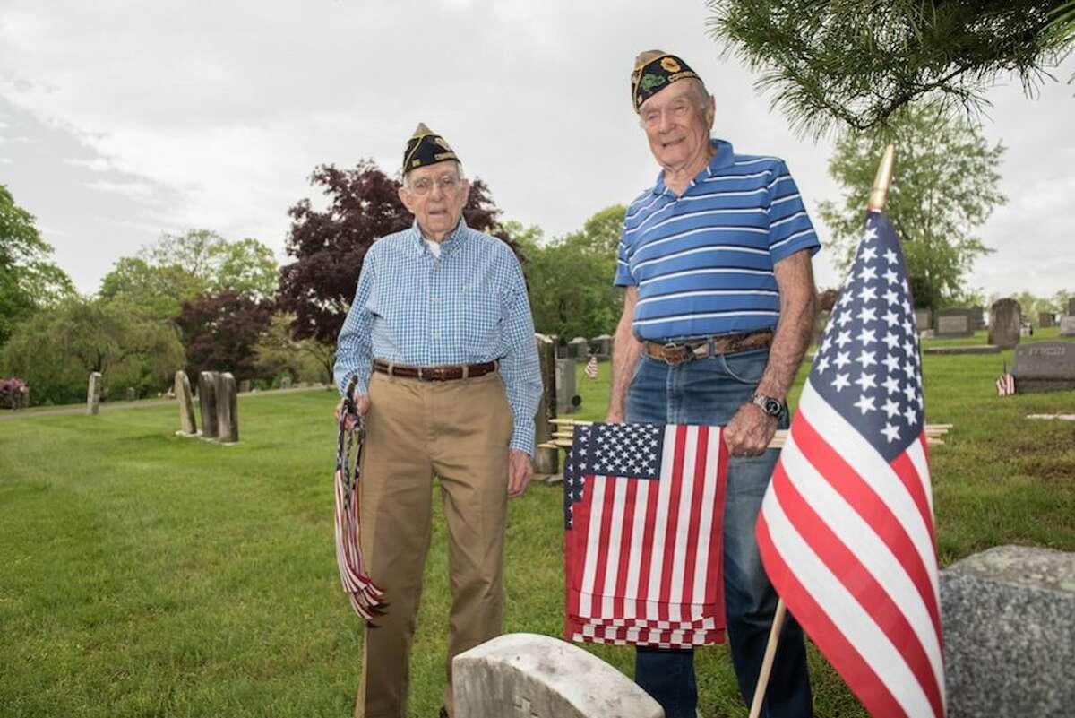 Veterans Judd Mott, left, and Bing Ventres at Hillside Cemetery.