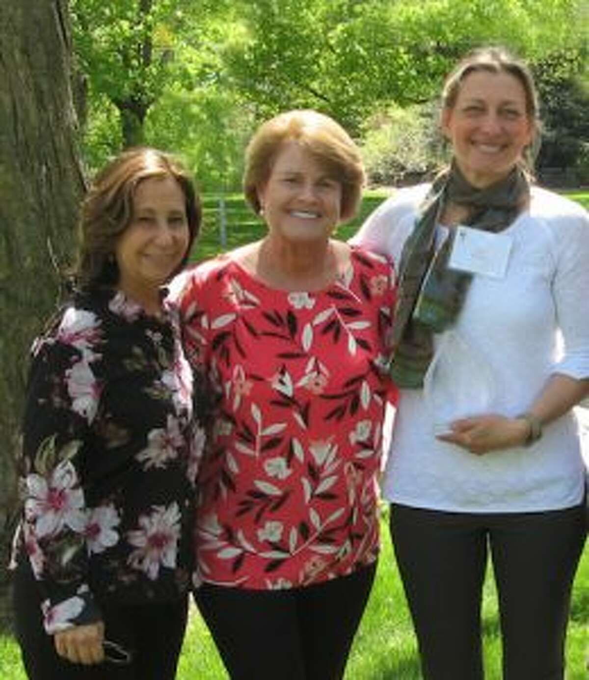 Deb Rackich of Redding, right, won the 2019 Carol Bauer Spirit Award, given by Visiting Nurse & Hospice of Fairfield County. She is joined by the agency's outgoing volunteer coordinator, Laurie Petrasanta, left, and Jennifer Toll of Wilton, Carol Bauer's daughter.