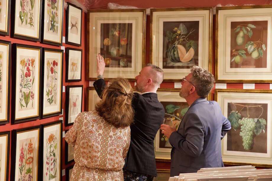 Visitors to Wilton Historical Society's Objects of Desire show last year view offerings.