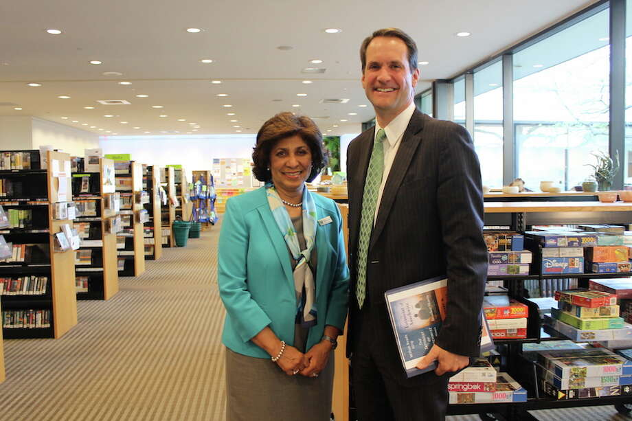 Wilton Library executive director Elaine Tai-Lauria welcomes Congressman Jim Himes to the library. — Contributed photo