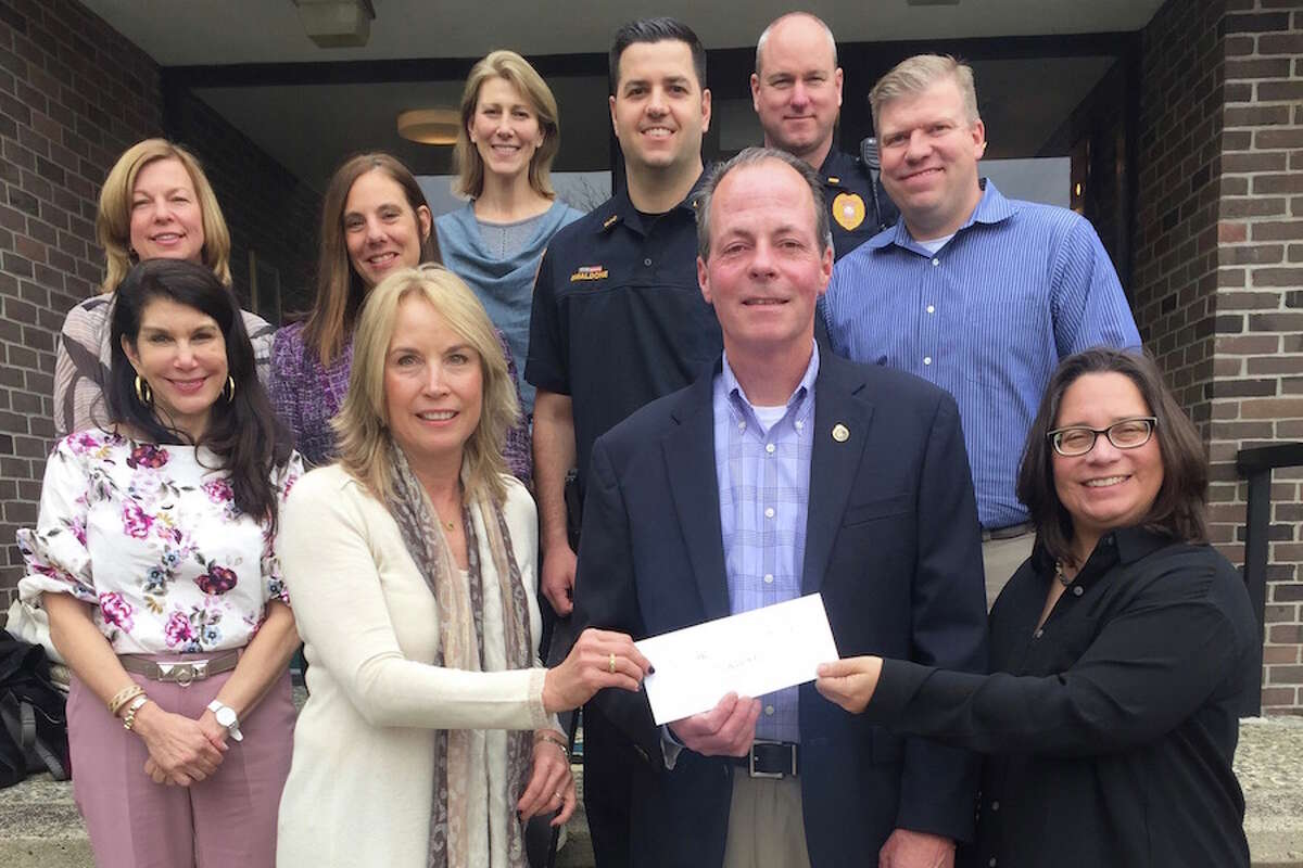 At a check presentation for the purchase of Narcan supplies by the Wilton Police Department are, front row, from left, Wilton Woman's Club Philanthropy co-chairs, Liz Salguero and Kathy Poirier with Wilton Police Chief John Lynch. Second row, from left, are club members Margaret Ogdon, Debbie Corrigan, Stacey Savas, and Mariann Bigelow; Officer Rob Smaldone, Lt. Gregg Phillipson and Capt. Tom Conlan.