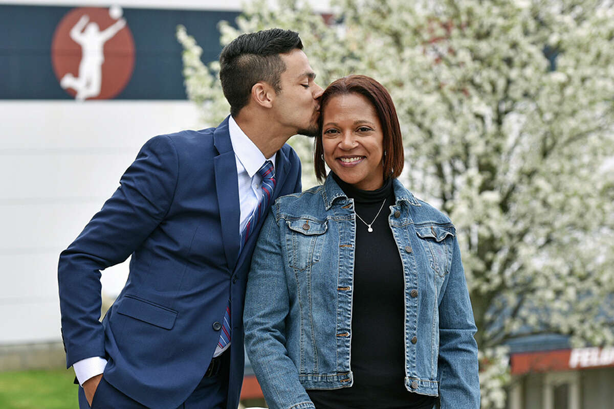 Chauncey Allers gives his mom Carole a kiss as the two prepare to graduate from Western Connecticut State University on Sunday, May 19. - Contributed photo