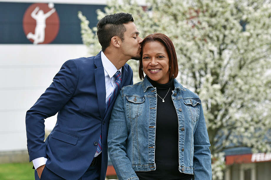Chauncey Allers gives his mom Carole a kiss as the two prepare to graduate from Western Connecticut State University on Sunday, May 19. — Contributed photo