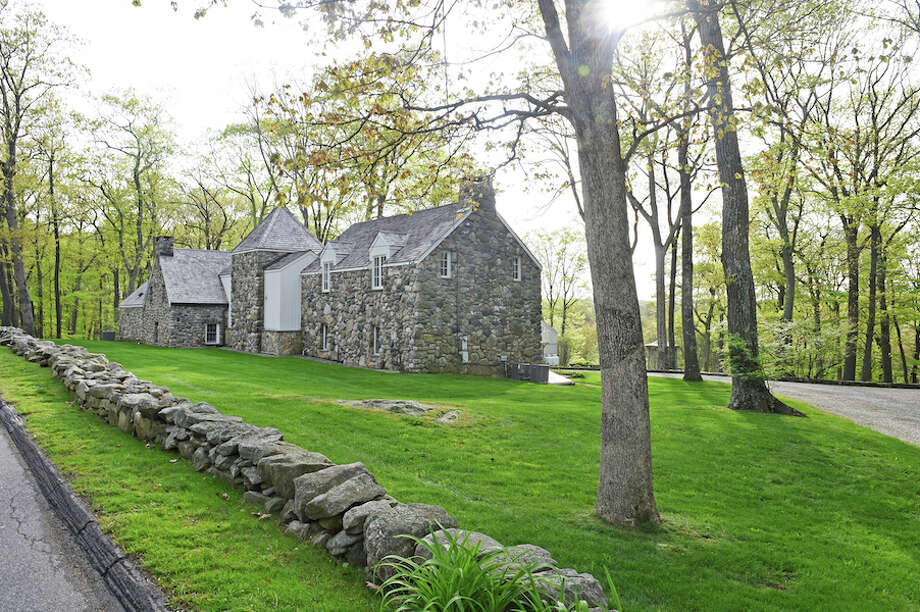 The stone house at 52 Millstone Road is at the center of a dispute between the property owners and the Wilton Land Conservation Trust. — Bryan Haeffele/Hearst Connecticut Media / BryanHaeffele