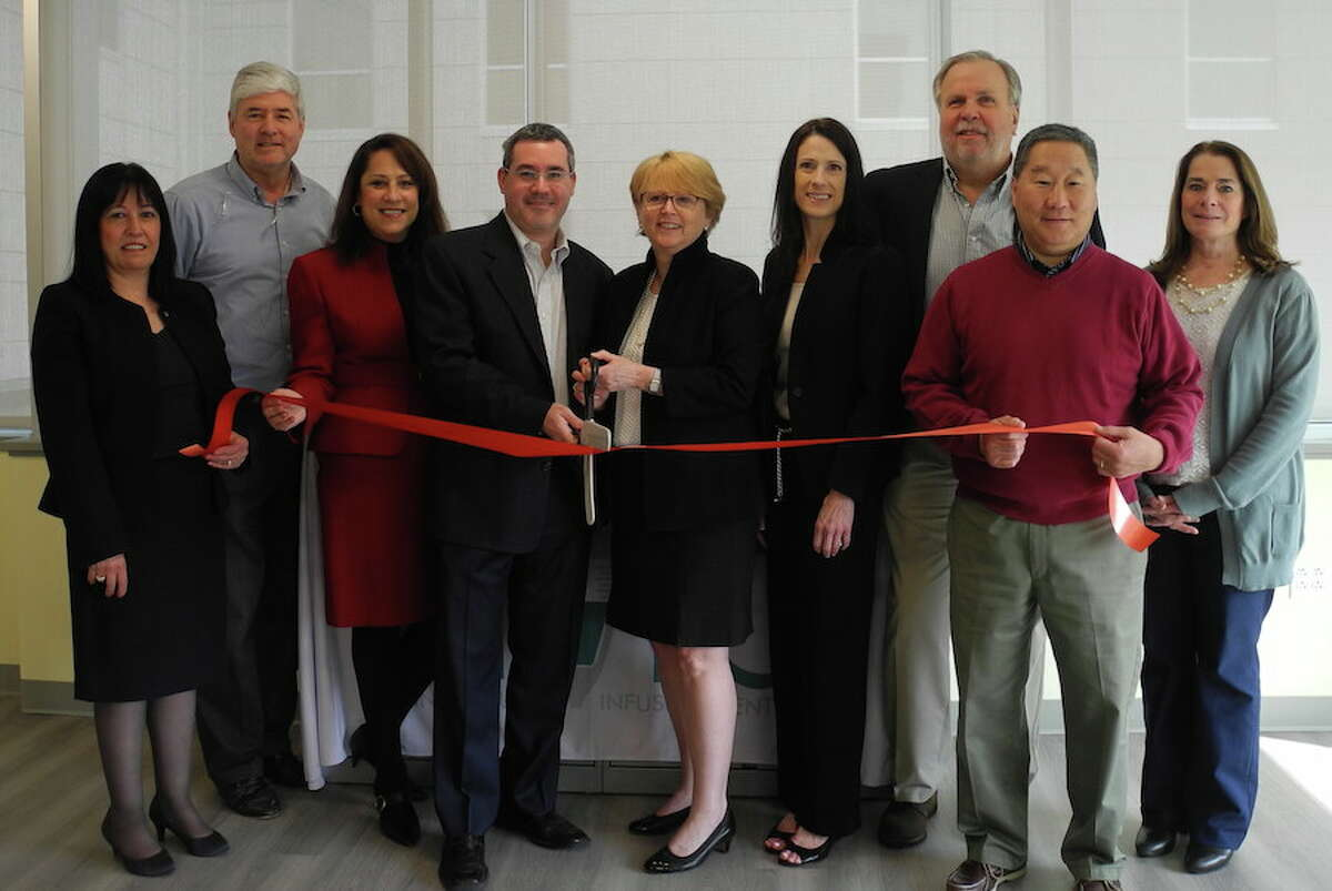 At the ribbon-cutting ceremony for the Connecticut Infusion Center on May 9 are, from left, Bankwell Vice President Vittoria Maccaro; Chamber of Commerce member Brian Perry; Debby Rowland, executive director of the infusion center; infusion center co-owner Dr. Barry Stein, First Selectwoman Lynne Vanderslice; Lisa Fusco, infusion center territory sales manager, and Pat Russo, Tom Sato and Susan Goldman of the Wilton Chamber of Commerce. Missing from photo is co-owner Dr. Robert Roteman. - Jeannette Ross/Hearst Connecticut Media