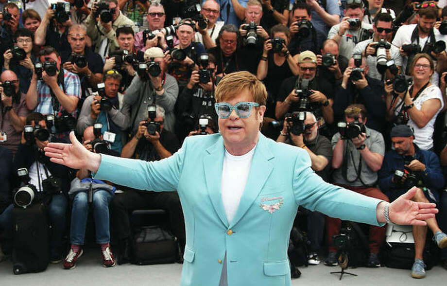 "In this May 16 photo, singer Elton John poses for photographers at the photo call for the film ""Rocketman"" at the 72nd international film festival, Cannes, southern France. Photo: Photo By Joel C Ryan/Invision/AP