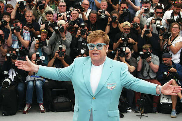 """In this May 16 photo, singer Elton John poses for photographers at the photo call for the film """"Rocketman"""" at the 72nd international film festival, Cannes, southern France."""