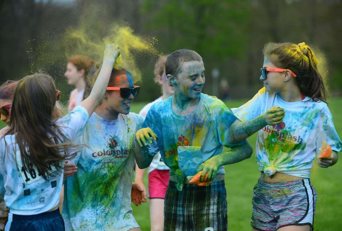 Along the route, participants pass through color splash zones, where they are doused with colored powder.