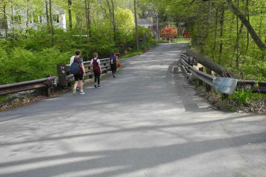 Pedestrians walk along the bridge at Lovers Lane.