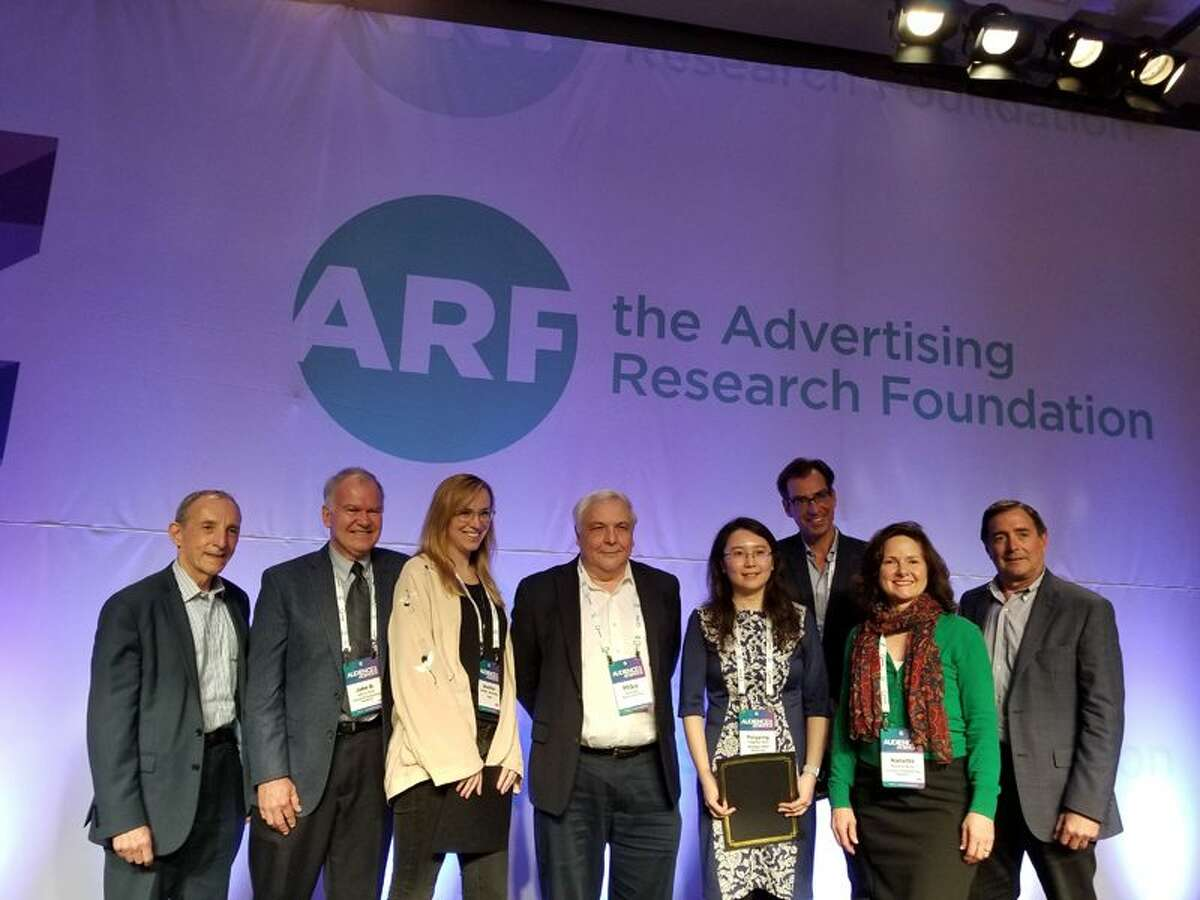 Mike Hess (center) was recently awarded 'Best Reviewer' by the Journal of Advertising Research. - contributed photo
