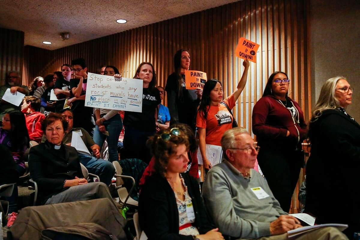 Supporters of covering up or removing the controversial mural at George Washington High School wait to speak during the San Francisco Unified School District board meeting where the board decided to remove or cover up the mural Tuesday, June 25, 2019, in San Francisco, Calif.