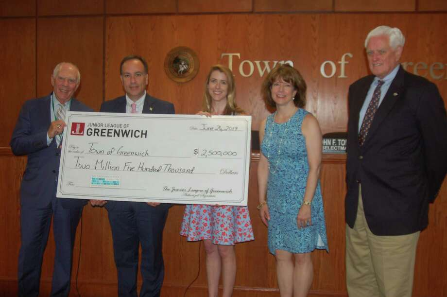 The Junior League of Greenwich presents the final dollars needed to complete its $2.5 million pledge for a public/private partnership with the town to build the town's new municipal pool on Wednesday, June 26, 2019, at Greenwich Town Hall. The pool was opened last year to great success and the league has delivered on its pledge on schedule. From left, Selectman Sandy Litvack, First Selectman Peter Tesei, League President Elizabeth Peyton, President-Elect Hilary Watson and Selectman John Toner are all on hand for the presentation. Photo: Ken Borsuk / Hearst Connecticut Media /