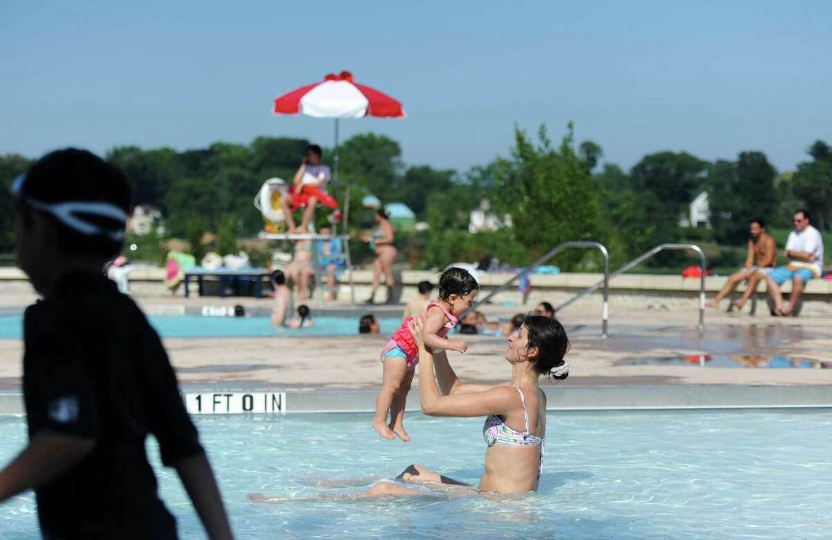 Gloriana Barba, of Greenwich, plays with her daughter, Evie, at the new Greenwich Pool at Byram Park in the Byram section of Greenwich, Conn. Monday, July 2, 2018.