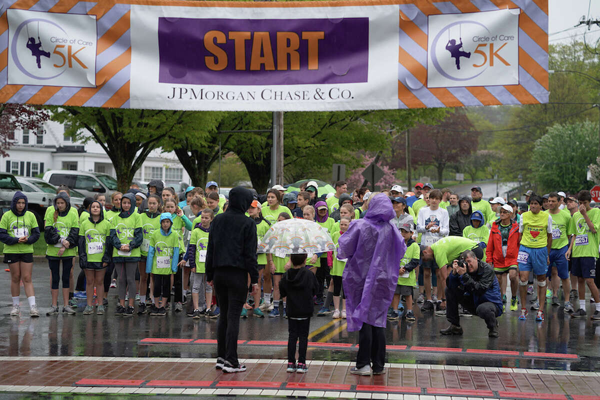 Victoria Diaz at the start of the 5K with her mother, Emily Padilla, left, and Circle of Care co-founder Liz Salguero.