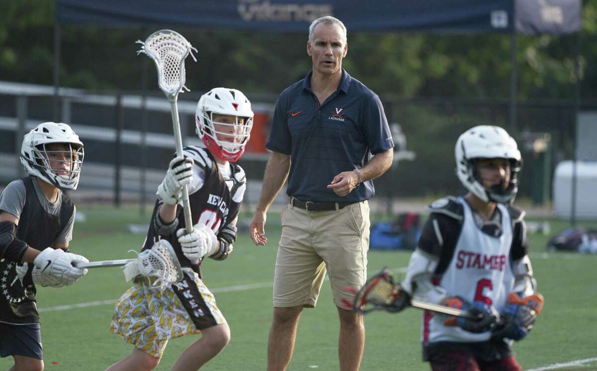 University of Virginia men's lacrosse coach Lars Tiffany coaches some middle school players during a clinic at King School in Stamford on Tuesday. Tiffany also gave a talk with a question and answer session at the King Performing Arts Center.