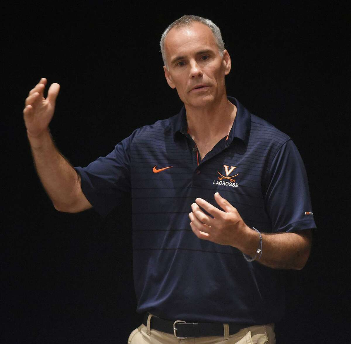 University of Virginia men's lacrosse coach Lars Tiffany addresses the audience during a talk, including a question and answer session, at the King Performing Arts Center at King School in Stamford on Tuesday.