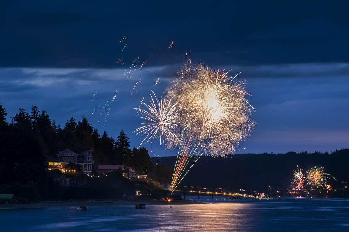 Fireworks display at Agate Pass between Bainbridge Island and the Olympic Peninsula.