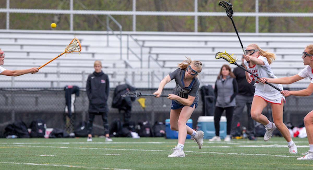 Olivia Gladstein fires a shot during Tuesday night's game against New Canaan. - GretchenMcMahonPhotography.com