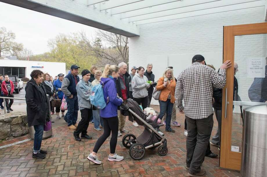 A line forms for the opening of the Annual Gigantic Book Sale at the Wilton Library on Sunday, April 28.