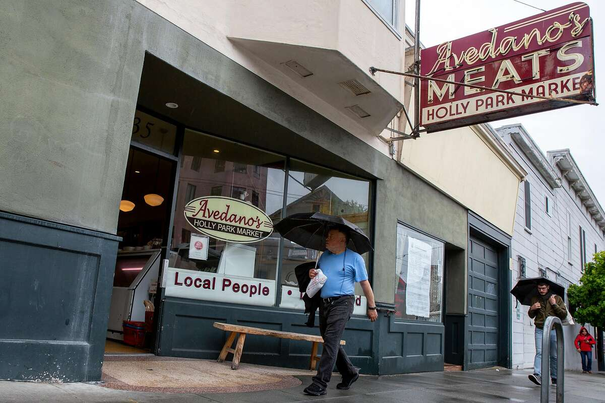 People walk past Avedano's Meats on Wednesday, May 15, 2019, in San Francisco, Calif.