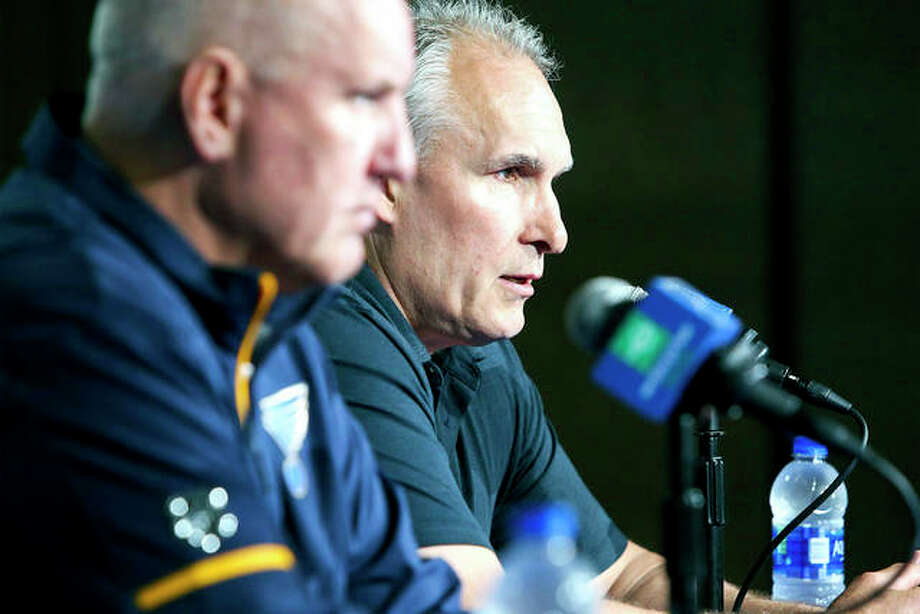 Blues coach Craig Berube, rear, and general manager Doug Armstrong speak during a press conference Wednesday in St. Louis. Berube, who led the franchise to its first Stanley Cup title this season, signed a three year contract with the team on Tuesday, officially removing his interim title. Photo: AP Photo