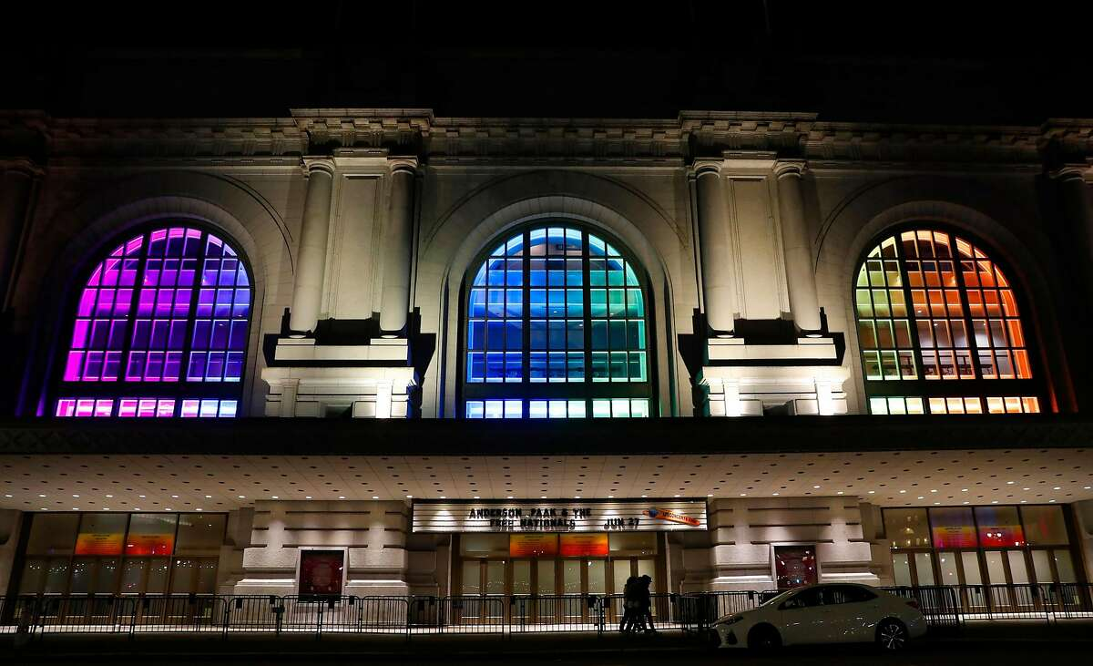 The rainbow colors of the Pride flag shine inside the windows of Bill Graham Civic Auditorium in San Francisco, Calif., on Tuesday, June 25, 2019.