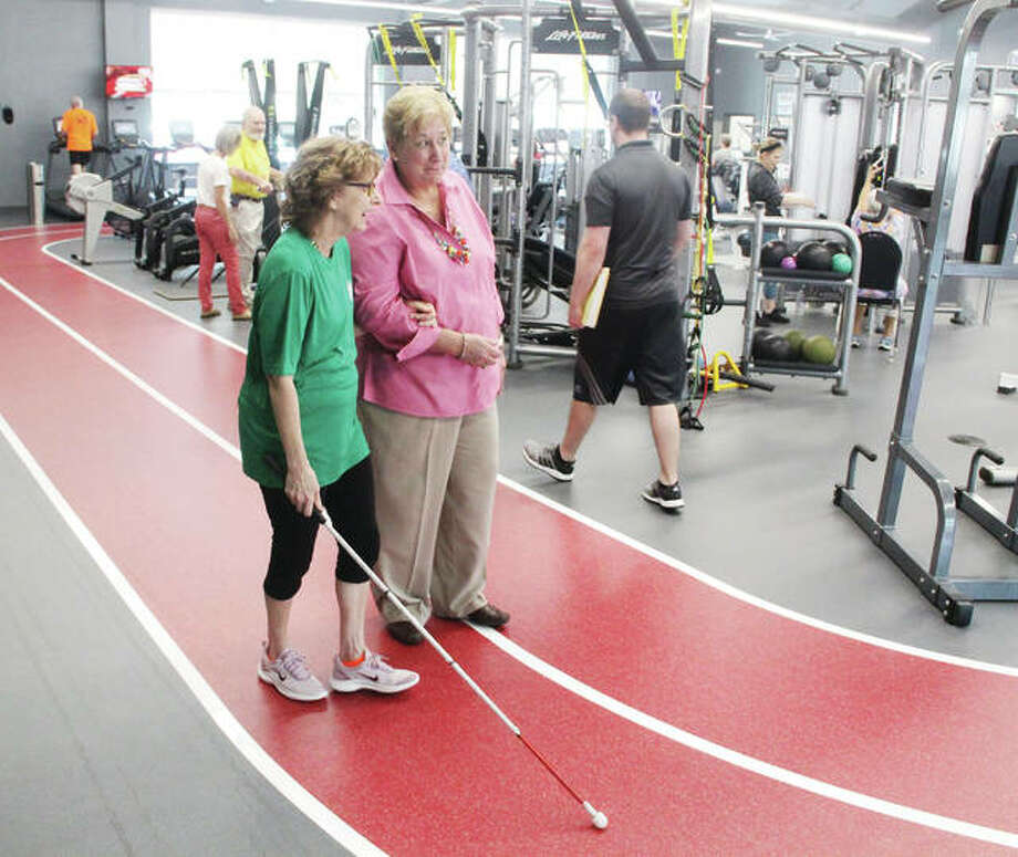 Linda Sethaler, left, an Ambassador for Senior Services Plus in Alton, makes her way around the walking track at SSP's Wellness Center with Illinois Department on Aging Director Paula Basta during a visit Wednesday morning. Basta and Deputy Director Lora McCurdy toured the facility, noting they were very impressed with the facility and its services. Basta said that, with some increased funding in the budget, they hope to be able to expand some services for senior citizens.