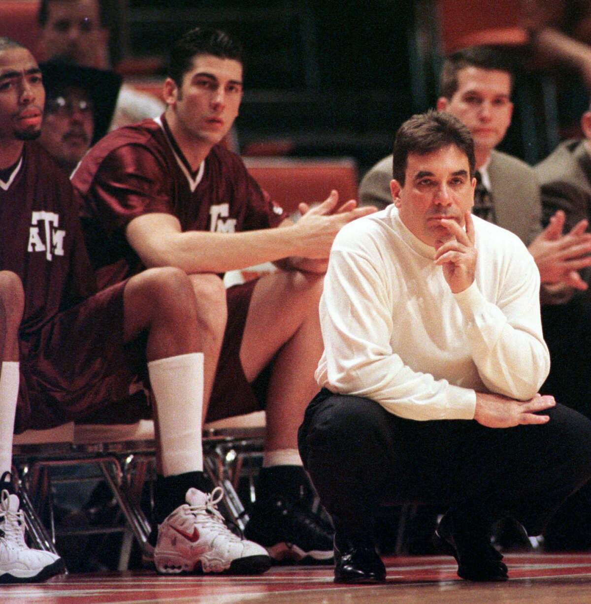 Texas A&M coach Tony Barone, front, watches his team's play during the first half against Texas on Wednesday, Feb. 18, 1998, in Austin, Texas. Texas won 87-74, giving the Aggies a 14-game losing streak and an 0-13 record in conference play. (AP Photo/George Bridges)