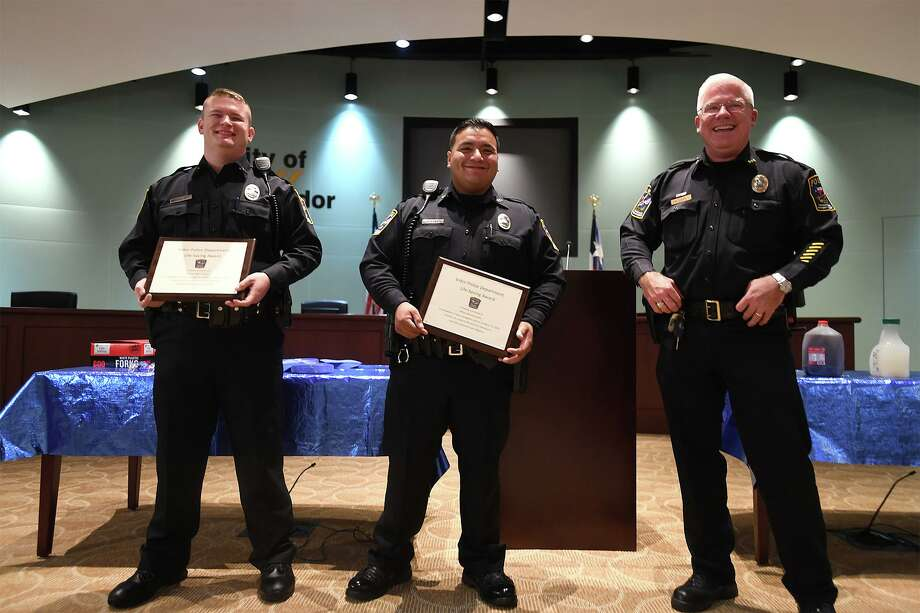 Vidor Police Chief Rod Carroll, right, gives Life Saving Awards to officers Manny Castillo, center, and Dillon LaPoint Wednesday from their response to an emergency call earlier this year. Photo taken Wednesday, 6/26/19 Photo: Guiseppe Barranco/The Enterprise, Photo Editor / Guiseppe Barranco ©